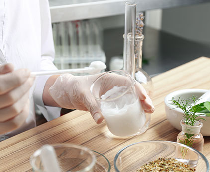 Lab technician creating and testing fragrances
